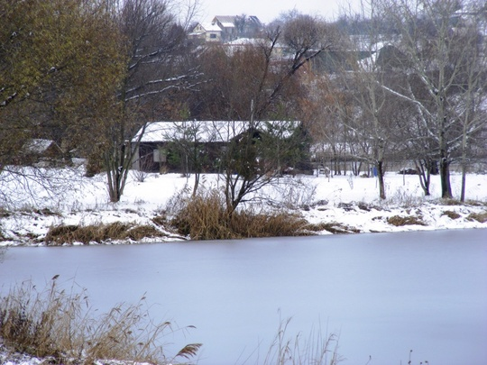 Cottage next to the frozen lake in Hungary
