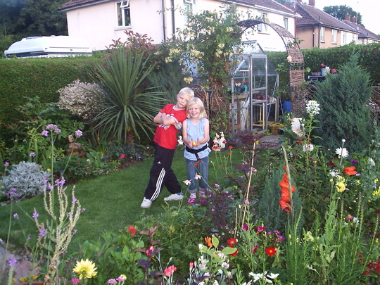 James and Eilidh in Janette's lovely garden, August 2008.