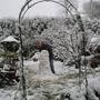 snowy garden and snowman