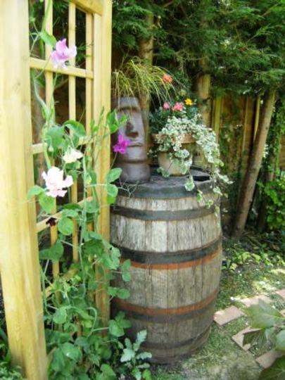 Funky garden ideas arch barrel and head for Funky garden designs