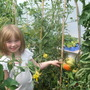 my niece Isabelle and our huge tomato