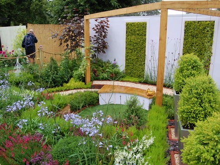 a garden pond can be drained and turned into a sheltered sunken seating spot