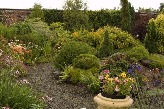 Comparison garden rockery photo