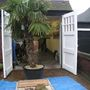 Blog 10.  Front garage - palm