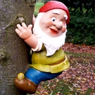 Gnome Climbing A Tree Ornament